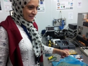 A staff scientist from Egypt, working in the IR lab.
